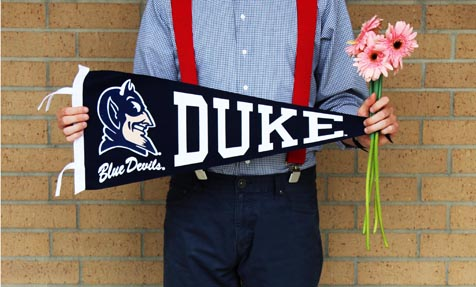 Man with Flowers and Duke Flag